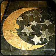 Stone mosaic moon and stars by Jim and Holly Cutting.