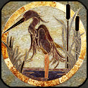 Stone mosaic heron with cattails and water.