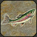 Rising stone mosaic fish with painted details.