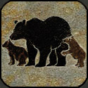 Stone mosaic silhouette bear with two cubs.