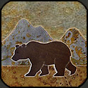 Stone mosaic silhouette bear and mountains.
