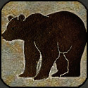 Stone mosaic silhouette standing bear.