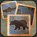 Stone mosaic trivets in wooden frames.